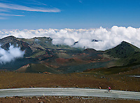 The Crater Road at the summit of HALEAKALA NATIONAL PARK on Maui in Hawaii is at an ekevation of 10,000 feet, yet this bike rider has accomplished what would be a fanatsy to most