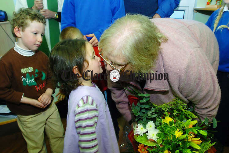 Minister of State at the Department of Education and Science Sile de Valera gets a kiss and flowers from 4 year old Laura Keane during the official opening of the Naoinra in Doonbeg.Pic Arthur Ellis.