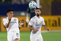CARSON, CA - SEPTEMBER 19: Joe Corona #15 of the Los Angeles Galaxy heads a ball during a game between Colorado Rapids and Los Angeles Galaxy at Dignity Heath Sports Park on September 19, 2020 in Carson, California.