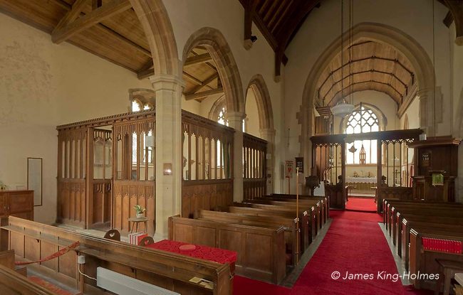 The nave of the Parish Church of St. Nicholas in Fyfield, Oxfordshire, UK. The Chantry chapel which was willed to the parish by John Golafre and which houses his 'memento mori' tomb, is in the aisle to the left of the nave. The church was rebuilt after being almost destroyed by fire in 1893.