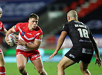 20th November 2020; Totally Wicked Stadium, Saint Helens, Merseyside, England; BetFred Super League Playoff Rugby, Saint Helens Saints v Catalan Dragons; Morgan Knowles of St Helens takes on Alrix da Costa of Catalan Dragons