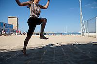 Maude practising Kalaripayattu, Plage des Catalans, Marseille, 16 June 2011. Kalaripayattu is a traditional Indian martial art and Maude practises here on the beach every morning.