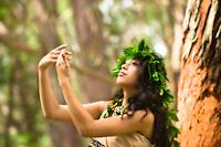 A Hawaiian dancer in kahiko or old-style attire, O'ahu.