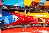 Rows of colorful kayak rentals.