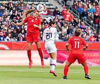 CARSON, CA - FEBRUARY 9: Shelina Zadorsky #4 of Canda goes up for a header with Christen Press #20 of the United States during a game between Canada and USWNT at Dignity Health Sports Park on February 9, 2020 in Carson, California.