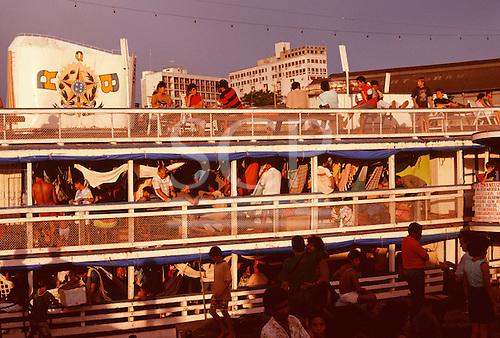 Manaus, Brazil. Fully-laden 'Gaiola' riverboat with passengers in hammocks. Amazonas State.