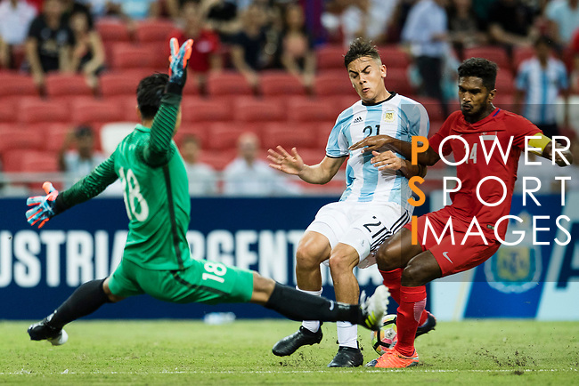 Paulo Dybala of Argentina (C) trips up with Hassan Sunny of Singapore (L) during the International Test match between Argentina and Singapore at National Stadium on June 13, 2017 in Singapore. Photo by Marcio Rodrigo Machado / Power Sport Images