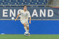 FOXBOROUGH, MA - AUGUST 5: Cole Frame #26 of North Carolina FC brings the ball forward during a game between North Carolina FC and New England Revolution II at Gillette Stadium on August 5, 2021 in Foxborough, Massachusetts.