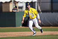 Michigan Wolverines outfielder Jackson Glines (27) leads off during the NCAA season opening baseball game against the Texas State Bobcats on February 14, 2014 at Bobcat Ballpark in San Marcos, Texas. Texas State defeated Michigan 8-7 in 10 innings. (Andrew Woolley/Four Seam Images)