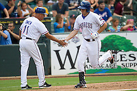 Round Rock Express outfielder Jarred Hoying (40) is congratulated by third base coach Spike Owen (11) after he hit a home run in the Pacific Coast League baseball game against the Salt Lake Bees on August 10, 2013 at the Dell Diamond in Round Rock, Texas. Round Rock defeated Salt Lake 9-6. (Andrew Woolley/Four Seam Images)