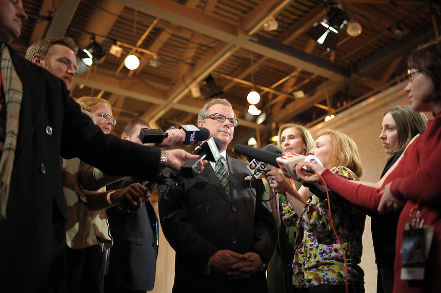 Saskatchewan Premier Brad Wall speaks with reporters following a testy leaders' debate with NDP leader Cam Broten at the CBC Saskatchewan building in Regina Wednesday, March 23, 2016. THE CANADIAN PRESS/Mark Taylor