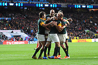 Captain Fourie du Preez of South Africa is swamped by teammates after scoring a try during Match 41 of the Rugby World Cup 2015 between South Africa and Wales - 17/10/2015 - Twickenham Stadium, London<br /> Mandatory Credit: Rob Munro/Stewart Communications