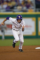 LSU Tigers outfielder Mark Laird #9 runs to third base against the Auburn Tigers in the NCAA baseball game on March 22nd, 2013 at Alex Box Stadium in Baton Rouge, Louisiana. LSU defeated Auburn 9-4. (Andrew Woolley/Four Seam Images).