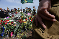 Relatives, friends and soldiers mourn  Pro-Russian activist Alexander Gizay at funerals of eight murdered by Ukraine army airstrike on Lugansk.