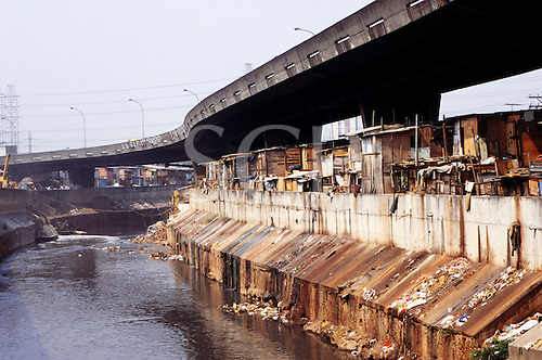 Sao Paulo, Brazil. Favela shanty town by the Tiete river showing pollution and rubbish.