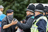 Pictured: A young man protests speaks to police officers. Monday 31 August 2020<br /> Re: Around 70 South Wales Police officers executed a dispersal order at the site of an illegal rave party, where they confiscated sound gear used by the organisers in woods near the village of Banwen, in south Wales, UK.