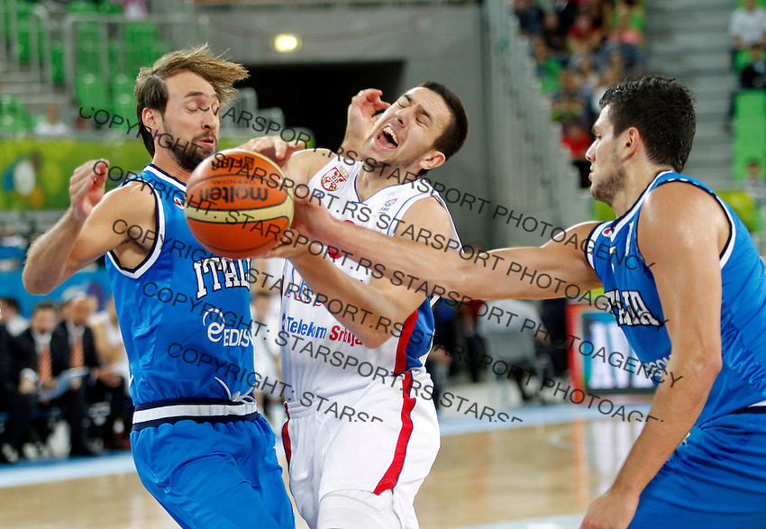 """Vasilije Micic of Serbia (C)  in action during European basketball championship """"Eurobasket 2013""""  basketball game for 7th place between Serbia and Italy in Stozice Arena in Ljubljana, Slovenia, on September 21. 2013. (credit: Pedja Milosavljevic  / thepedja@gmail.com / +381641260959)"""