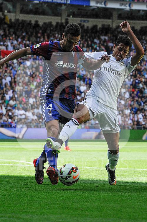 Real Madrid´s Chicharito and Eibar´s Jose Maria Anibarro during 2014-15 La Liga match between Real Madrid and Eibar at Santiago Bernabeu stadium in Madrid, Spain. April 11, 2015. (ALTERPHOTOS/Luis Fernandez)