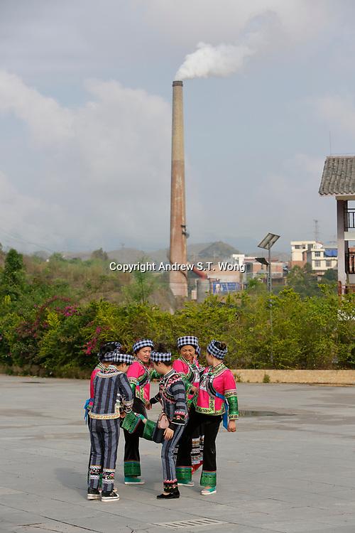 Women of the ethnic Bouyei Tribe dance at Wangmo County in China's southwestern Guizhou Province, April 2019.