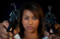 Female portrait with a gun