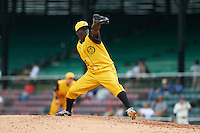 Jacksonville Suns pitcher Juancito Martinez (28) delivers a pitch during the 20th Annual Rickwood Classic Game against the Birmingham Barons on May 27, 2015 at Rickwood Field in Birmingham, Alabama.  Jacksonville defeated Birmingham by the score of 8-2 at the countries oldest ballpark, Rickwood opened in 1910 and has been most notably the home of the Birmingham Barons of the Southern League and Birmingham Black Barons of the Negro League.  (Mike Janes/Four Seam Images)