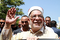 Abdelfattah Mourou (C), Tunisia's interim parliamentary speaker and Islamist-inspired Ennahda Party politician, waves to supporters and journalists after submitting his candidacy for the upcoming early presidential elections at the Independent High Authority for Elections (ISIE), in the capital Tunis on August 9, 2019. - Ennahdha Party had announced that Mourou would be their presidential candidate for the first time on August 7, ahead of polls next month. Mourou, 71, was appointed interim parliamentary speaker following the death last month of president Beji Caid Essebsi. The Ennahdha politician had previously served as the deputy speaker, and changed roles after the then parliamentary head Mohamed Ennaceur stepped up as interim president<br /> <br /> PHOTO : Agence Quebec Presse - jdidi wassim