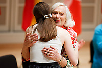 USA International Harp Competition Founder and Artistic Director Susann McDonald hugs Executive Director Erin Brooker-Miller during the opening ceremony of the 11th USA International Harp Competition at Indiana University in Bloomington, Indiana on Wednesday, July 3, 2019. (Photo by James Brosher)