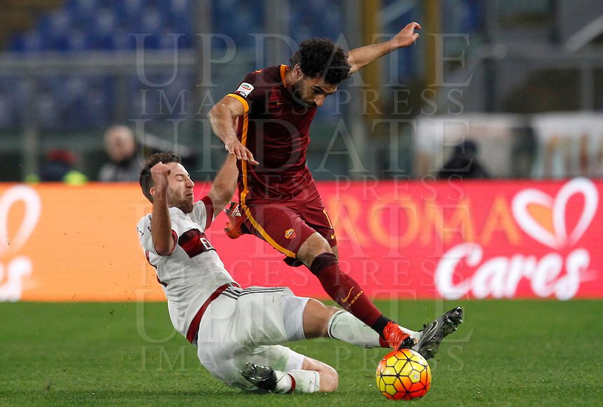 Calcio, Serie A: Roma vs Milan. Roma, stadio Olimpico, 9 gennaio 2016.<br /> Roma's Mohamed Salah, right, is tackled by AC Milan's Andrea Bertolacci during the Italian Serie A football match between Roma and Milan at Rome's Olympic stadium, 9 January 2016.<br /> UPDATE IMAGES PRESS/Riccardo De Luca