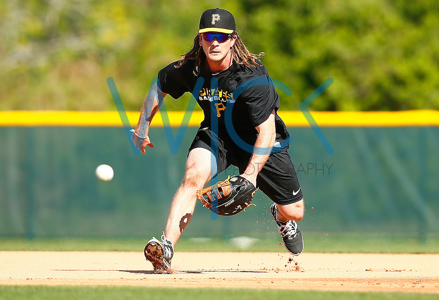 John Jaso #28 of the Pittsburgh Pirates practices at first base during spring training at Pirate City in Bradenton, Florida on February 17, 2016. (Photo by Jared Wickerham / DKPS)