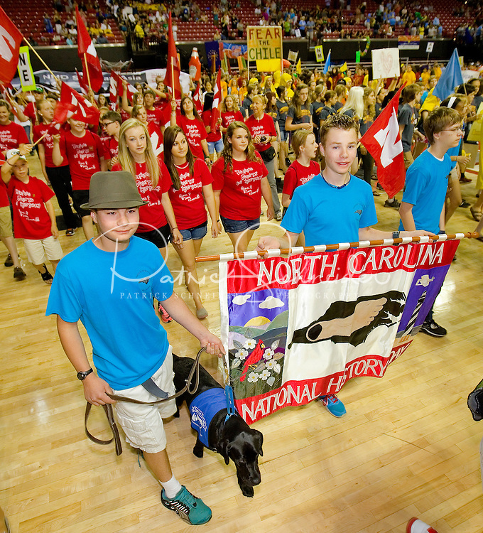 North Carolina students competed in the 2013 National History Day event. National History Day (NHD) is a highly regarded academic program for elementary and secondary school students. Each year, more than half a million students, encouraged by thousands of teachers nationwide participate in the NHD contest. Students choose historical topics related to a theme and conduct extensive primary and secondary research through libraries, archives, museums, oral history interviews and historic sites. After analyzing and interpreting their sources and drawing conclusions about their topics' significance in history, students present their work in original papers, websites, exhibits, performances and documentaries. These products are entered into competitions in the spring at local, state and national levels where they are evaluated by professional historians and educators. The program culminates in the Kenneth E. Behring National Contest each June held at the University of Maryland at College Park.