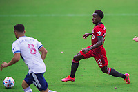 ORLANDO, FL - APRIL 24: Richie Laryea #22 of Toronto FC dribbles the ball during a game between Vancouver Whitecaps and Toronto FC at Exploria Stadium on April 24, 2021 in Orlando, Florida.