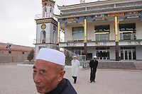 Local men outside of a mosque in the isolated town of Hongsibao, which lies 150km south of Ningxia's capital Yinchuan. It is completely surrounded by dry and arid land and is officially titled the 'Hongsibao Development Zone Poverty Reduction Project'. Some 200,000 people have been relocated to the town from local mountainous areas, suffering as a result of the harsh, dry climes and increasing desertification.