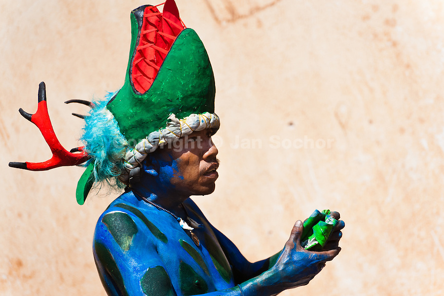 """A Cora Indian man, wearing a colorful demon mask, takes a part in the religious ritual ceremony of Semana Santa (Holy Week) in Jesús María, Nayarit, Mexico, 22 April 2011. The annual week-long Easter festivity (called """"La Judea""""), performed in the rugged mountain country of Sierra del Nayar, merges indigenous tradition (agricultural cycle and the regeneration of life worshipping) and animistic beliefs with the Christian dogma. Each year in the spring, the Cora villages are taken over by hundreds of wildly running men. Painted all over their semi-naked bodies, fighting ritual battles with wooden swords and dancing crazily, they perform demons (the evil) that metaphorically chase Jesus Christ, kill him, but finally fail due to his resurrection. La Judea, the Holy Week sacred spectacle, represents the most truthful expression of the Coras' culture, religiosity and identity."""