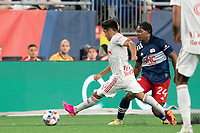 FOXBOROUGH, MA - MAY 22: Frankie Amaya #8 of New York Red Bulls chases down the ball near the New England Revolution goal during a game between New York Red Bulls and New England Revolution at Gillette Stadium on May 22, 2021 in Foxborough, Massachusetts.