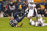 Pitt running back Qadree Ollison scores on a 13-yard touchdown run despite the efforts of Penn State safety Ayron Monroe (23) and Lamont Wade (38). The Penn State Nittany Lions defeated the Pitt Panthers 51-6 on September 08, 2018 at Heinz Field in Pittsburgh, Pennsylvania.