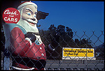 Santa Claus figure at used car lot in L.A.