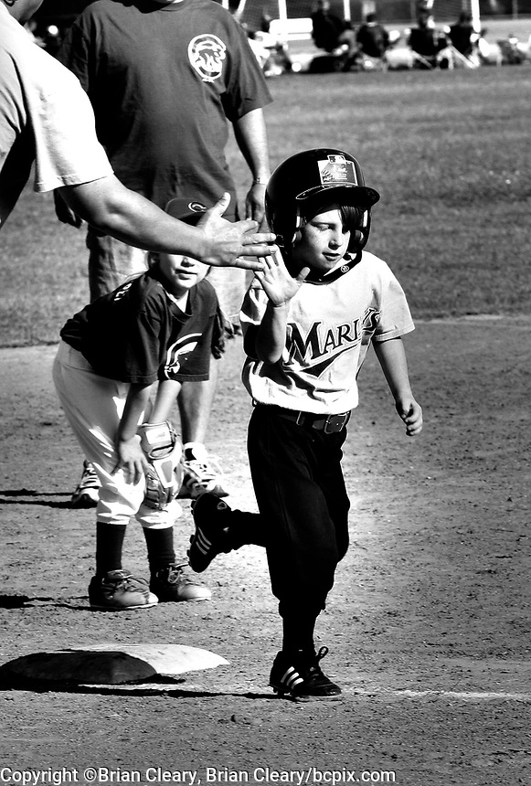 Black and white tee ball action . (Photo by Brian Cleary/www.bcpix.com)