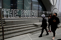 NEW YORK - NEW YORK - APRIL 02: People walk in front of The Shed sign at Hudson Yards on April 02, 2021 in New York. New York takes another step forward to reopening arts and entertainment, venues are allowed to welcome back people with the guidelines say indoor spaces can have up to 100 audience members and outdoor venues can have 200. (Photo by John Smith/VIEWpress)