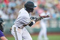 Vanderbilt Commodores designated hitter Ro Coleman (1) squares to bunt against the TCU Horned Frogs in Game 12 of the NCAA College World Series on June 19, 2015 at TD Ameritrade Park in Omaha, Nebraska. The Commodores defeated TCU 7-1. (Andrew Woolley/Four Seam Images)