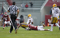 Arkansas linebacker Grant Morgan (31) tackles DUPLICATE***LSU quarterback TJ Finley (11), Saturday, November 21, 2020 during the fourth quarter of a football game at Donald W. Reynolds Razorback Stadium in Fayetteville. Check out nwaonline.com/201122Daily/ for today's photo gallery. <br /> (NWA Democrat-Gazette/Charlie Kaijo)