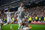 Real Madrid's Chicharito cerebrates a goal (1-0) with Raphael Varane, Cristiano Ronaldo and Sergio Ramos during quarterfinal second leg Champions League soccer match against Atletico de Madrid at Santiago Bernabeu stadium in Madrid, Spain. April 22, 2015. (ALTERPHOTOS/Victor Blanco)