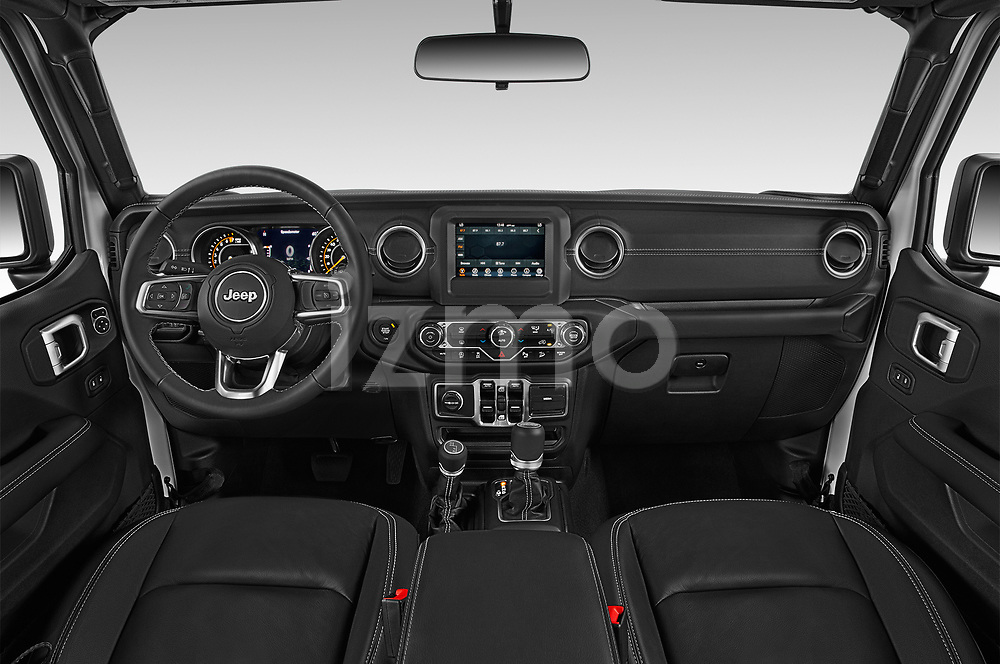 Stock photo of straight dashboard view of a 2018 Jeep Wrangler Unlimited Sahara 5 Door SUV