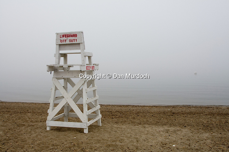 Lifeguard stand on the beach in early morning fog