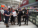09/08/15<br /> <br /> ***with video***<br /> <br /> Protesting dairy farmers brought chaos to an Asda store today when they marched two cows through the aisles to the dairy produce area of the supermarket in Stafford where a spokesman called for the public's support to increase the amount dairy farmers are paid for mllk.<br /> <br /> All Rights Reserved - F Stop Press.  www.fstoppress.com. Tel: +44 (0)1335 418629 +44(0)7765 242650