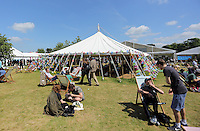 HOT AND SUNNY WEATHER PICTURE WALES<br />Hay on Wye. Friday 03 June 2016<br />People rest on the festival green at the Hay Festival, Hay on Wye, Wales, UK