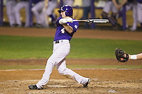 LSU Tigers outfielder Raph Rhymes #4 follows through on his swing against the Auburn Tigers in the NCAA baseball game on March 23, 2013 at Alex Box Stadium in Baton Rouge, Louisiana. LSU defeated Auburn 5-1. (Andrew Woolley/Four Seam Images).