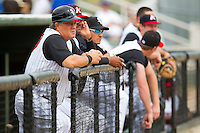 Kannapolis Intimidators manager Tommy Thompson #39 watches the action from the top step of the dugout during the South Atlantic League game against the West Virginia Power at Fieldcrest Cannon Stadium on April 20, 2011 in Kannapolis, North Carolina.   Photo by Brian Westerholt / Four Seam Images
