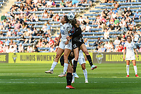 BRIDGEVIEW, IL - JULY 18: Sofia Huerta #11 of the OL Reign and Morgan Gautrat #13 of the Chicago Red Stars battle for the ball in the air during a game between OL Reign and Chicago Red Stars at SeatGeek Stadium on July 18, 2021 in Bridgeview, Illinois.