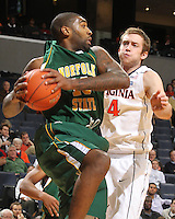 Dec. 20, 2010; Charlottesville, VA, USA; Norfolk State Spartans guard/forward Rodney McCauley (15) grabs the rebound in front of Virginia Cavaliers forward Will Regan (4) during the game at the John Paul Jones Arena. Virginia won 50-49. Mandatory Credit: Andrew Shurtleff