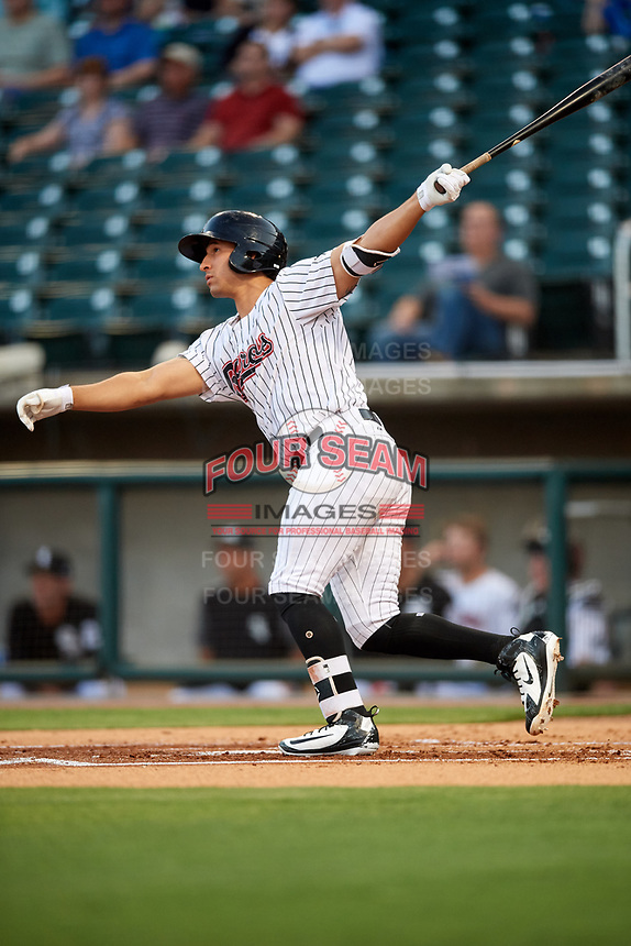 Birmingham Barons designated hitter Seby Zavala (19) hits a home run in the bottom of the first inning during a game against the Pensacola Blue Wahoos on May 8, 2018 at Regions FIeld in Birmingham, Alabama.  Birmingham defeated Pensacola 5-2.  (Mike Janes/Four Seam Images)